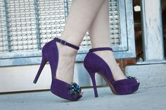 Purple suede platforms with a T-strap, gems, and feathers? Yes, yes, and yes.  Photographed by Denisio Truitt