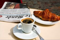 paris cafe croissant coffee and newspaper