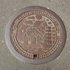 Bergen, Norway. In Norway the manhole covers are beautifully detailed.