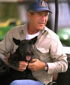 President George W. Bush with his best buddy Barney.