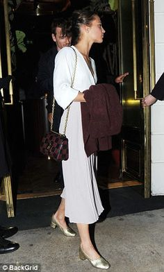 Feminine: The brunette beauty finished off her feminine ensemble with gold pumps and a che...