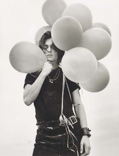 johnny depp with balloons,1992 • bruce weber -- I like the balloons surrounding him - for a more artistic guy