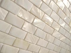 shimmering white tiles | sophisticated mother of pearl patterns. Shimmering