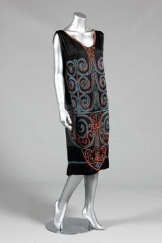 The beadwork is just amazing and all hand done. The design of the dress is a tabard, with the back hanging down similar to a cape.