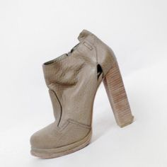 """Alexander Wang Olive Booties 39 Olive leather booties by Alexander Wang. Tiny cutouts at heel. 1"""" platform at toe, 5"""" heel with angled edge. Zips up one side. Pretty much awesome!! Excellent used condition with a little bit of wear. No original box. The price is firm. No trades please. Alexander Wang Shoes Ankle Boots & Booties"""
