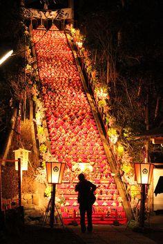 Hina-Matsuri  (The Japanese Doll's Festival) ,Approximately 1,200 hina dolls are displayed on the 60 stone steps of sando (an approach) of Tomisaki-jinja Shrine.