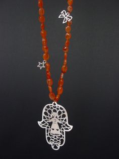Necklace 'Fatima and Ingrid'.  Two dutch girls in one hand.