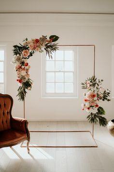 Copper Piping Wedding Decor with Pink Flowers and Palm Leaves   By Elena Popa Photography   Coral Wedding Decor   Peach Wedding Decor   Industrial Wedding   Pink Wedding Flowers   Peach Wedding Flowers   Burgundy Wedding Suit   Wedding Decor   Wedding Ceremony Decor   Coral Wedding Decorations, Decor Wedding, Burgundy Wedding, Industrial Wedding, Wedding Suits, Red Flowers, Altar, Wedding Flowers, Palm