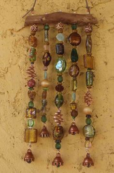 Beaded Wind Chime ( windchime ) Sun Catcher ( suncatcher ) on Mesquite Wood with Glass Beads, Crystals, and Bells. $25.00, via Etsy.