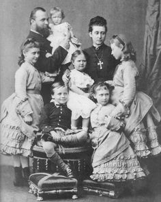 Ella's family in 1876, two years before the death from diphtheria of Ella's mother and sister May: Her brother Frederick, who was a hemophiliac, had died in 1874 after a fall. The photo shows Ella's father Louis holding May, Victoria at his side, Ernest and Irene at the front, Ella with her hand on Irene's shoulder and leaning against her mother, and Ella's mother Alice holding on to Alix (the future Empress Alexandra Feodorovna), Photo: Wikipedia