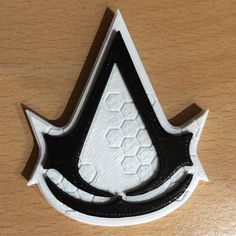 3D printed assassins creed logo.  -Forg3d props