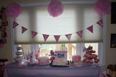 Dessert table for pink elephant 1st Birthday party.