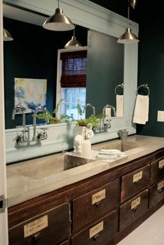The trough sink/mirror combo is amazing. The drawers are nice and big in that gorgeous rustic medium-toned wood and I love the labels on the outside of the drawers!