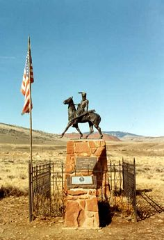 """Jeremiah """"liver-eating"""" Johnston. Bronze statue of Liver-Eating Johnson erected over his grave at Old Trail Town in Cody, Wyoming"""