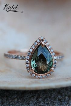 Green Tea sapphire Rose gold engagement ring in pear cut.