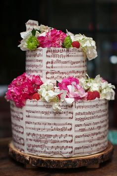 Custom hand painted cakes with unique designs.  wedding cake music notes pattern flowers