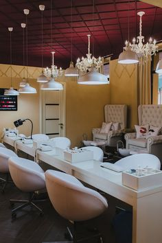 LAYOUT OF PEDICURE STATIONS WITH MANICURE TABLES JUST IN FRONT OF THEM + MANICURE CHAIRS & TABLES