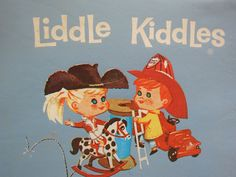 Liddle Kiddles were pre-Polly Pocket.  They came in lockets and had names like Slipsy Sliddle and Lemons Stiddle.