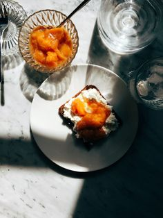 Peach jam with cottage cheese spread over toasted rye bread.