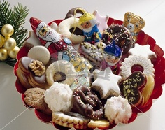 On December 6th, German children get home made cookies, nuts, apples, sweets on a decorated plate