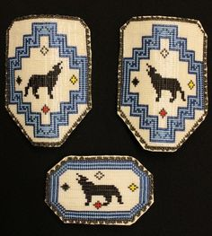 White, blue, and black beaded wolf hair clip set with delica beads. All with finished leather backs. Judy Baraniuk. #Beadwork #Wolf