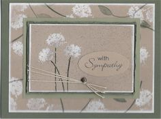 Cardmaker unknown. Stamp the green parts onto kraft cardstock. Let dry. Then stamp the white blossoms & heat emboss. Sponge the edges of the two kraft panels with white ink.. I like the layers, the embossed white blossoms, and the string anchored by a brad.