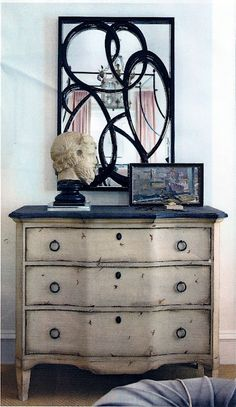 Above a chest of drawers with a distressed finish is a mirror with an artistic edge. Its inset of swirls lends contrast to the bright space. Recycled Furniture, Furniture Projects, Furniture Makeover, Painted Furniture, Home Furniture, Interior Decorating, Interior Design, Decorating Ideas, Decorating Mirrors