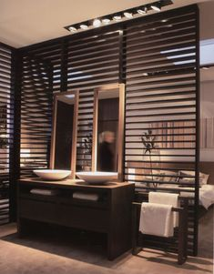 Wooden partition wall between bathroom and bedroom.