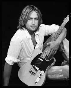 Keith Urban- mine and my husband's favorite country musician of today. This man is one talented musical explosion! He has some serious guitar skills.  I started liking him in high school and I saw him in concert 2 years ago for Chuck's bday! :)