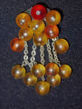 Rare Miriam Haskell Bakelite WWII Beaded Pin at Bangles & Beads on Ruby Lane through January.