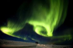 """Aurora Borealis, or """"The Northern Lights,"""" fill the sky over Finnmark, Norway, March 13, 2011."""