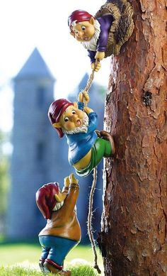 Climbing Gnomes Tree Decor...how cute is this? Esp with the castle in the background. Now, THAT may be a little tough to recreate!