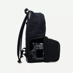 The Jumper Backpack by Brevite is a Jansport bag on the outside, a camera bag on the inside. Fits a laptop and side tripod holder.