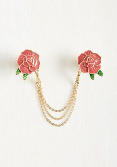 No neckline is too crowded for a style boost from this floral collar pin! With twin, enamel-painted roses accented by tiny green leaves, and a tripled golden chain, this ModCloth-exclusive accessory adds a welcome retro touch to your outfit.