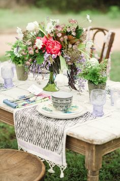 bohemian wedding reception, photo by Lindsey Stump Photography http://ruffledblog.com/austin-styled-bridal-session #bohemian #bohowedding #centerpieces