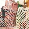 Crochet a lightweight and reusable shopping bag for trips to the supermarket or other stores. These bags are comfortable to carry and keep you from wasting plastic bags.