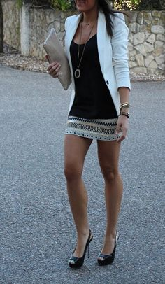 Attractive fashion White blazer, pendant necklace, embellished skirt. Or Hooker heels, crotch duster, white blazer, perfect legs.