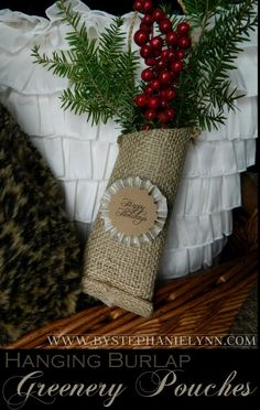 Hanging Burlap Greenery Hangers - Recycle cardboard tubes and hang seasonal greenery mixed with faux berries. You can also use these as door hangers or gift toppers.