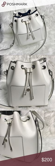 Michael Kors Greenwich Medium Bucket Bag MICHAEL KORS Greenwich Medium Bucket Bag *top handle with adjustable shoulder strap *exterior snap pocket, interior slip pocket *white with silver hardware *interior is a deep navy color   My bf bought this for me at the MK store in WC last year and it's 100% authentic! It's in great condition considering I only worn it out like twice lol Don't remember how much it was so I checked online and it retails for $298 & another site sells $319 for the white…