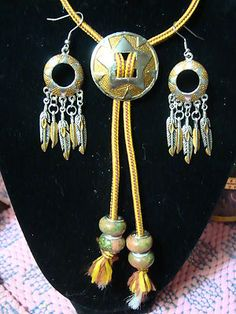 Women's concha bolo tie with matching earrings. $16.99