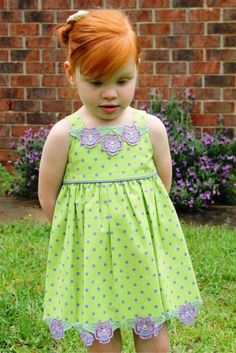 Free-standing lace, made in the hoop and sewn on to a wee dress.