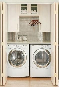 Laundry Likes:  1. Cabinets for Storage  2. Folding Counter  3. Hanging Space for Clothes (may not be enough space?)   4. Idea of a back splash in the laundry room...  Will still need to paint and still like wainscoting on remaining three walls. by sharonsparkles