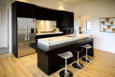 Brodie & Niki Retallick's on trend black kitchen with indoor vertical herb garden #blackkitchen  #verticalgarden #house #interiordesign #brodieretallick #generationhomes