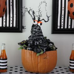 Spooky Center of Attention Centerpiece  Your Halloween party table will be the center of attention with a centerpiece this spooky! Turn an ordinary foam pumpkin into an enchanting display with foam shapes, fabrics and glow-in-the-dark accents.
