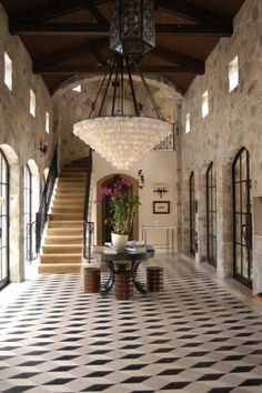 Elegant entry with stairs, tile floor, industrial windows and timberframe high ceiling
