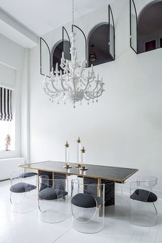 Curved acrylic chairs are fitting with this grand and opulent space.