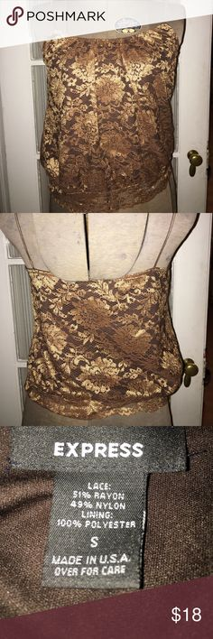 Express Lace Shiny Copper Tank size 2 Express Lace Shiny Copper Tank size 2. 51%Rayon/49%Nylon 100%Polyester Lining. This top is so pretty & appears metallic! Smoke Free Home. Express Tops Camisoles