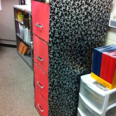 I put wrapping paper around my file cabinet and used red construction paper for the front of the drawers. I have it matching my teacher'a desk to tie it all together.
