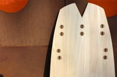 Fishtail of wooden surfboard with Mahagony plugs