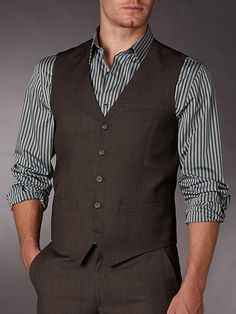I like this brown suit and vest look for the groomsmen. Not with that shirt